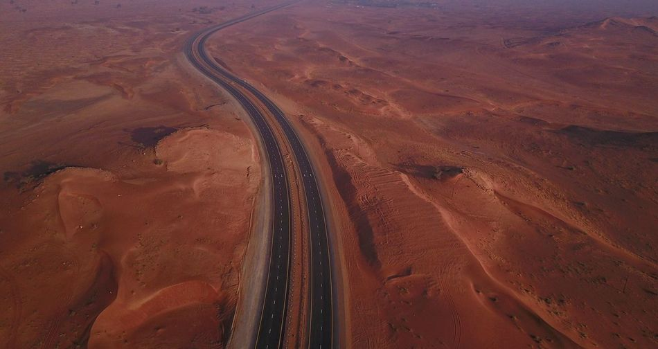 Road High Angle View Landscape Transportation Nature Day Brown Aerial View Outdoors Physical Geography Arid Climate Sand No People Beauty In Nature Sand Dune