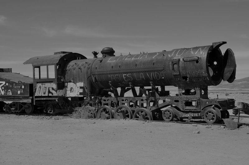 Locomotive on field against sky