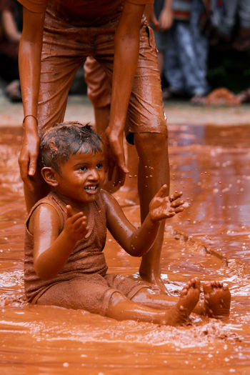 Mud Festival Of Goa. Human Body Part Water Wet Travel Destinations Splashing Human Hand Social Issues Close-up People Adult Day Animal Body Part Outdoors Beauty Low Section Mammal Cultures Elephant Goa Eyeem_bestshots Goa_tourism Mygoa MudFestival Mudfight Selective Focus