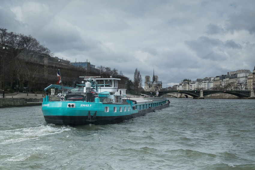 Notre-Dame Cargo Boat Mode Of Transport Nautical Vessel River Seine Transportation Water Waterfront