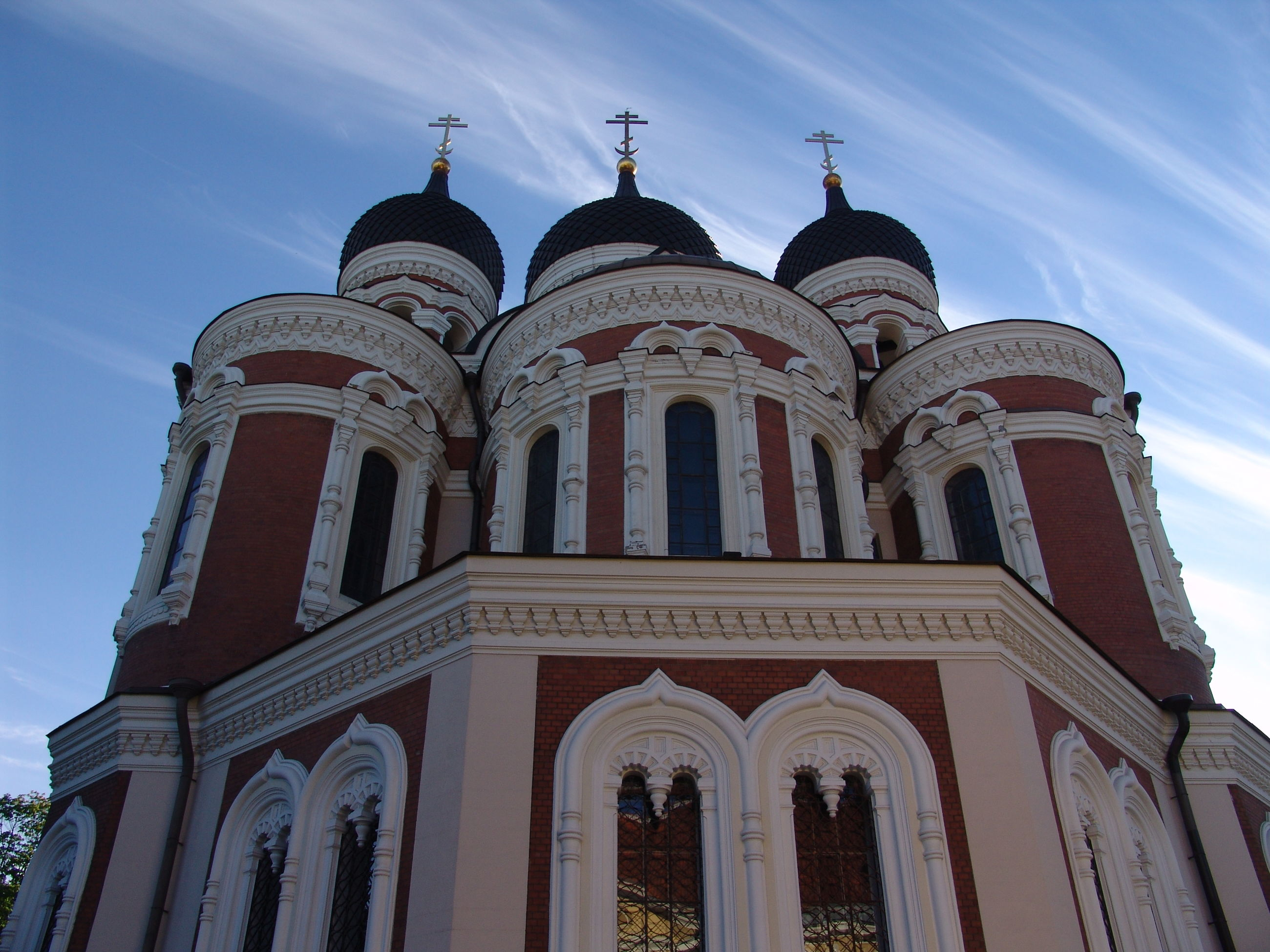 architecture, built structure, low angle view, building exterior, sky, church, religion, place of worship, dome, arch, spirituality, travel destinations, facade, famous place, blue, history, cathedral, outdoors