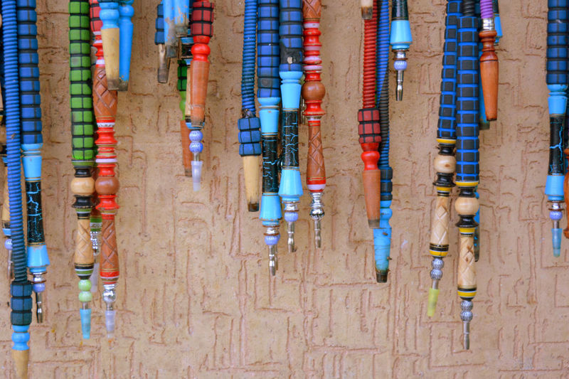 High angle view of multi colored pencils in row