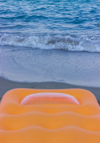 Aquatic Sport Beach Close-up Day Focus On Foreground Motion No People Orange Color Sand Sea Sport Water Waterbed Wave