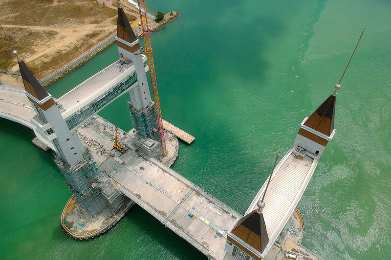 drawbridge under construction Nautical Vessel Water Transportation Mode Of Transportation High Angle View Sea Day Nature No People Ship Moored Outdoors Green Color Waterfront Beauty In Nature Travel Metal Scenics - Nature Tranquility Turquoise Colored