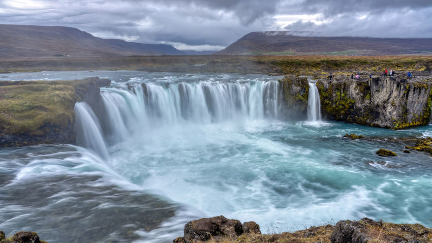 The Goðafoss is a waterfall in Iceland. It is located in the Bárðardalur district of Northeastern Region at the beginning of the Sprengisandur highland road. The water of the river Skjálfandafljót falls from a height of 12 meters over a width of 30 meters. Scenics - Nature Water Beauty In Nature Waterfall Motion Long Exposure Nature Flowing Water No People Outdoors Power In Nature Flowing Goðafoss Waterfall Sunrise Sunset Environment Blurred Motion Majestic Beauty In Nature Horseshoe Falls Rocks Cloud - Sky Land Power Rock Sky Mountain Landscape