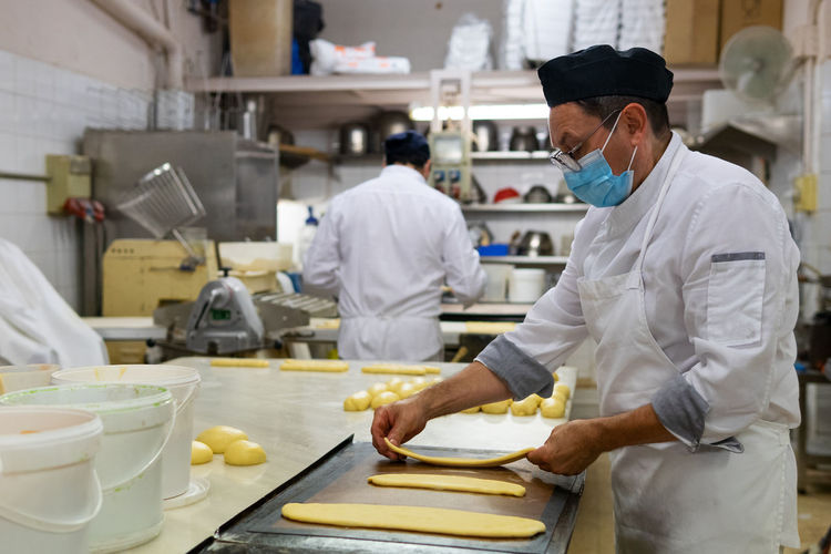 Man working with food in kitchen