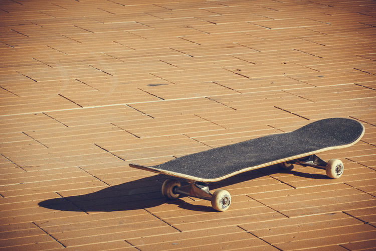 Professional skateboard posed on the floor