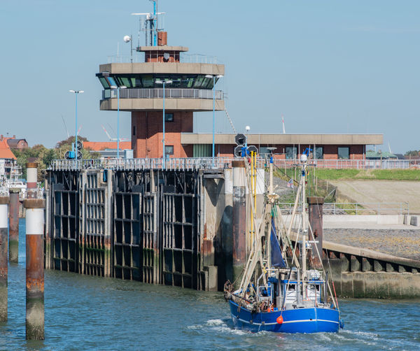 Floodgate to the harbor from the direction of the North Sea Fishing Port Harbor Industry North Sea Coast Building Coast Cutter Docks Fishing Boat Flood Control Floodgate Harbor Area Lock Lock Gates Navigation North Sea Sea Ship Ship Lock Shipping  Tower Water Watercraft Waterway
