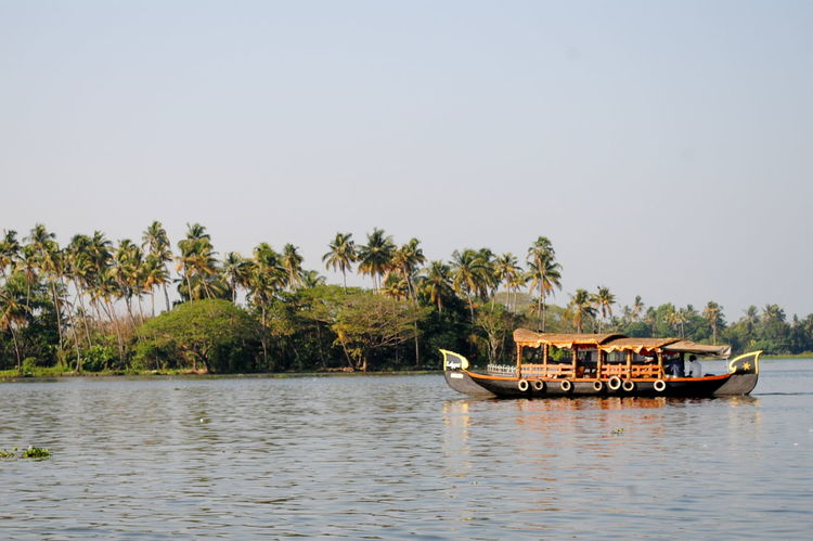 Beauty In Nature Boat Calm Clear Sky Day Growth Idyllic Kerala Mode Of Transport Nature Nautical Vessel No People Non-urban Scene Outdoors Rippled Scenics Sky Tourism Tranquil Scene Tranquility Transportation Tree Water Waterfront