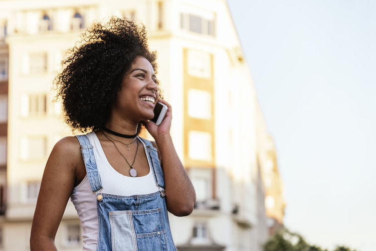 Smiling Woman Talking On Smart Phone