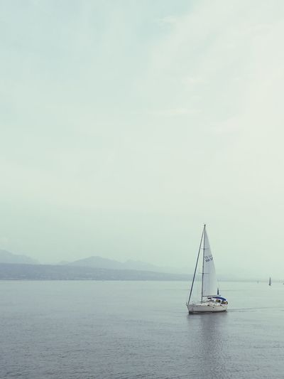 Switzerland Lac Léman Sailing Tranquil Scene Sailboat Nature Non-urban Scene No People Travel Tranquility Outdoors Sky Tranquility Water Cloud - Sky Travel