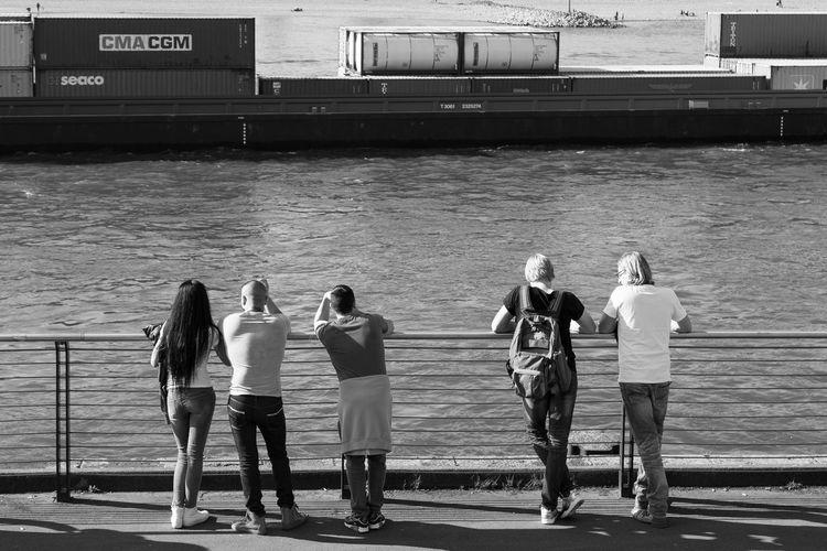 Rheinufer, Duesseldorf, Germany Black & White Black And White Blackandwhite City Life Deutschland Duesseldorf Düsseldorf Germany Real People Rhein Rheinufer Rheinufer Düsseldorf River Schwarzweiß Ship Standing Young Adult