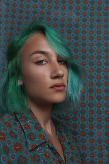 Portrait of beautiful young woman with dyed hair