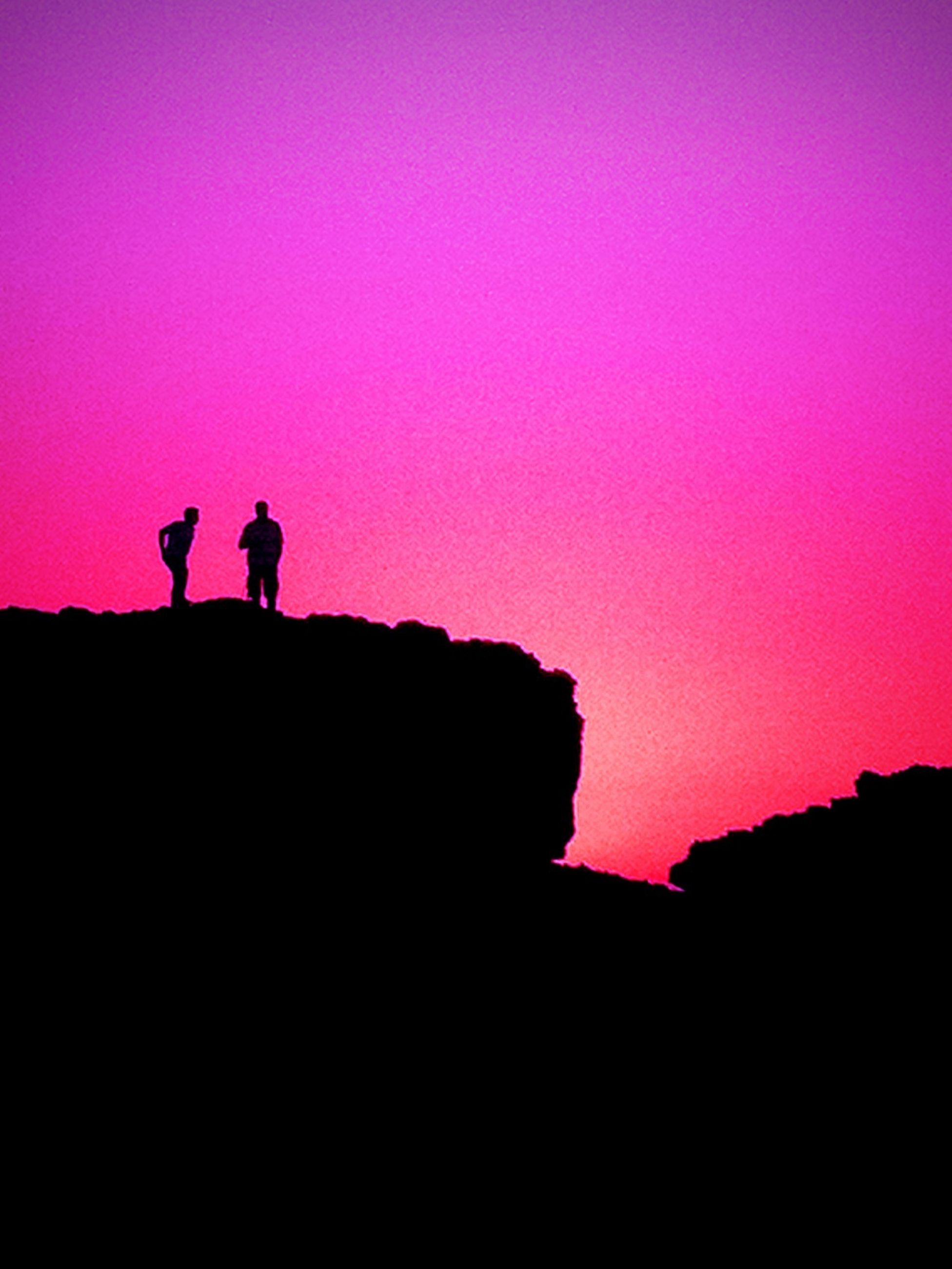 silhouette, lifestyles, men, copy space, leisure activity, sunset, standing, person, full length, togetherness, clear sky, sky, outline, dusk, rear view, unrecognizable person, red