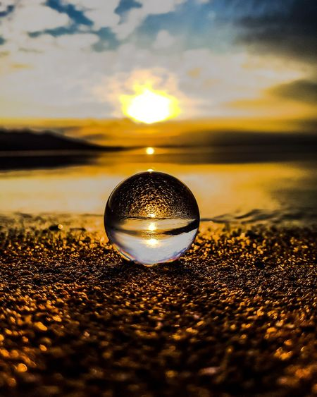 EyeEm Selects Lensball Gramslayers Light Lights Night Lights EyeEmNewHere Love Sun Beach Reflection Shiny Crystal Ball Disco Ball Backgrounds Sunset No People Crystal Close-up Nightclub Water Beauty In Nature Outdoors Nature Day
