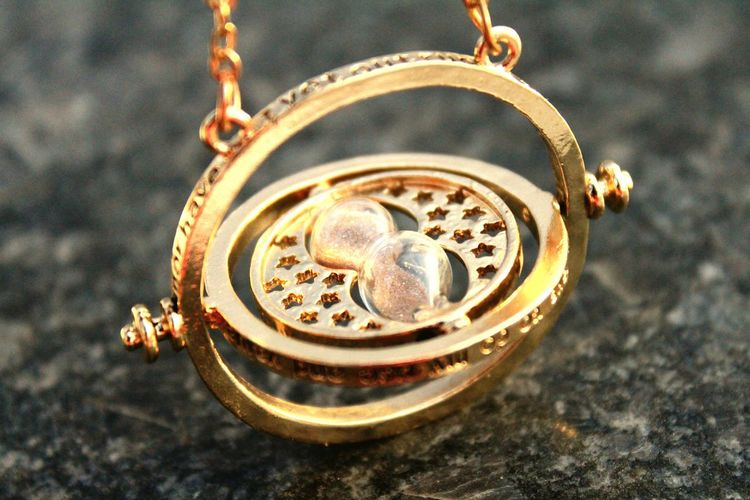 TimeTurner Colour Gold Time Turner Harry Potter Souvenirs Gift Read Time With Sand Granite Tabletop Harry Potter Theme Luxury High Angle View Jewelry Close-up Personal Accessory