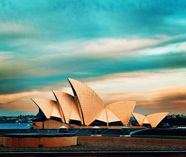 House of opera 😜 Architecture Colours EyeEm Gallery EyeEm Picoftheday Photooftheday Iconic Sky Cloud - Sky Building Exterior Architecture Built Structure City No People Travel Destinations Arts Culture And Entertainment Transportation Nature Outdoors Building Water Sunset Travel Tourism Modern