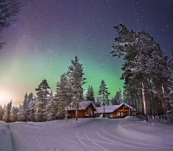 Northern Light in Snowscape Aurora Holiday Lapland Northern Lights Architecture Astronomy Beauty In Nature Building Exterior Built Structure Cold Temperature Long Exposure Nature Night No People Outdoors Scenics Sky Snow Snowscape Star - Space Tranquil Scene Tranquility Tree Wallpaper Winter