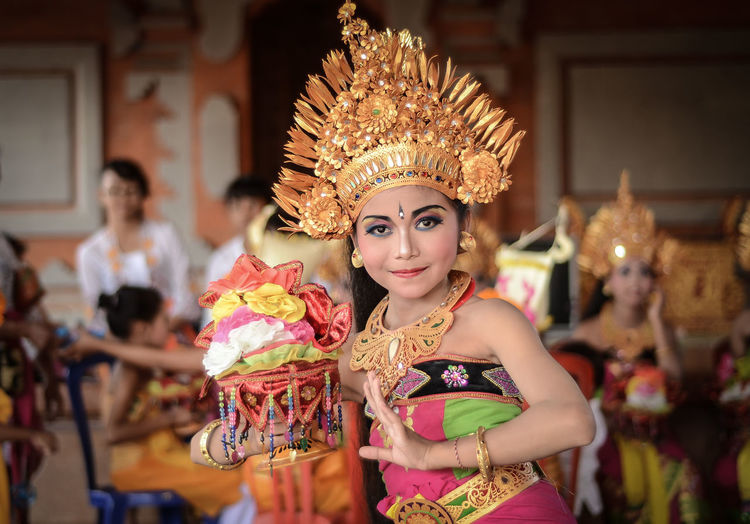Beautiful Balinese dancer poses in front of the camera before perform Rejang Dewa dance in Tabanan, Bali. Bali Bali, Indonesia Dance Gold Balinese Balinese Culture Balinese Dancer Balinesegirl Beautiful Woman Beauty Color Colorful Dancer Gold Colored Headdress Headwear Portrait Real People Rejang Rejang Dewa Tabanan Traditional Traditional Clothing Women Young Women