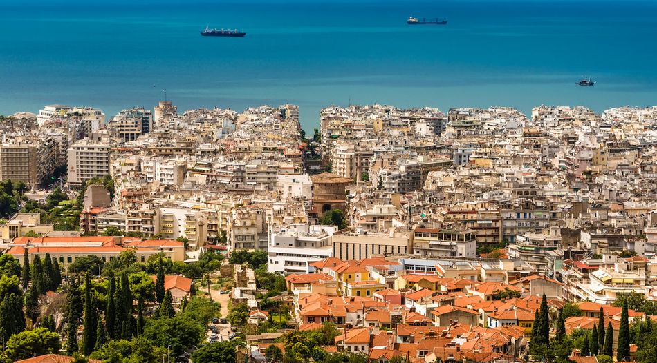 Flying Ships over Thessaloniki Architecture Building Exterior Cityscape City Built Structure Building Day Outdoors City Landscape Boats Panorama Thesaloniki Greece Vacations Vacation Time Streets Roofs And Towers Sea Water Blue Sea Ships Flying Ships Flying Boats