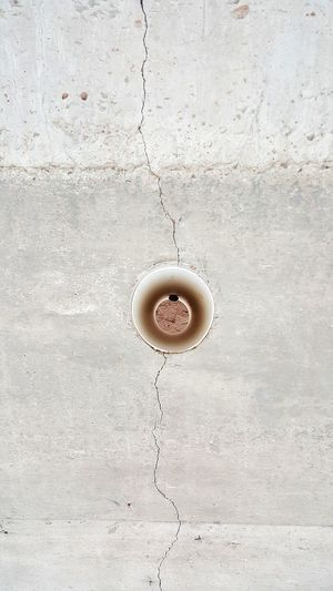 Directly above shot of coffee cup on wall