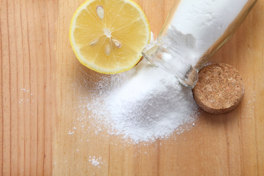 top view of baking soda and lemon Agent Antacid Anti Inflammatory Baking Sheet Bicarbonate Cleaning Compound Directly Above Enviromental Healthy Heap Holistic Ingredient Lemon Medical Neutralizer No People Nontoxic Powder Sodium Bicarbonate Top View Wooden Background