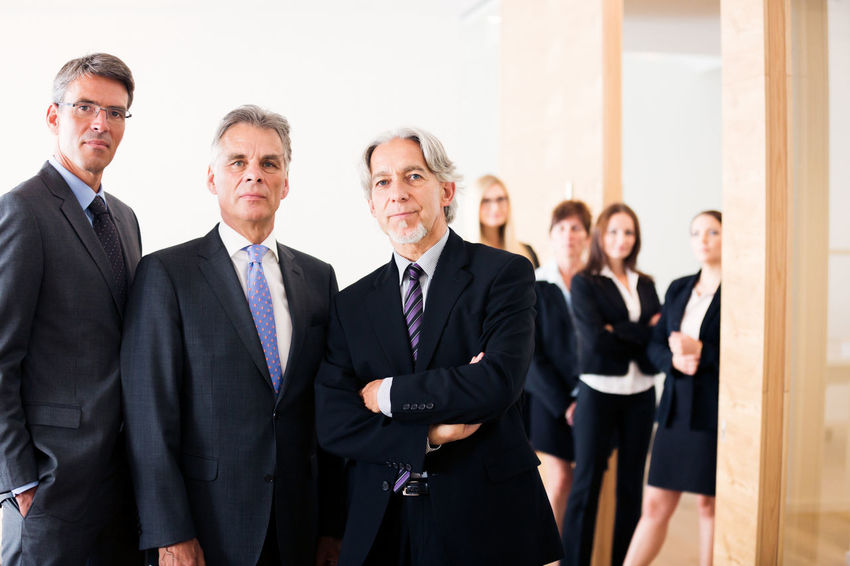 Business Company Office Teamwork Well Dressed Business Finance And Industry Business Person Businessman Businesswear Businesswoman Caucasian Group Group Of People Group Shot Indoors  Mature Adult Medium Group Of People Men People Portrait Professional Suit Team Togetherness Women