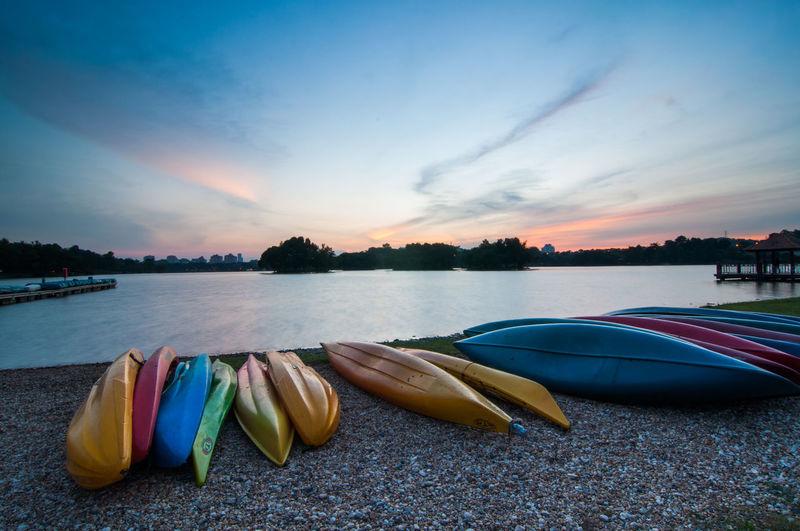 Upside down kayak at lakeshore during sunset