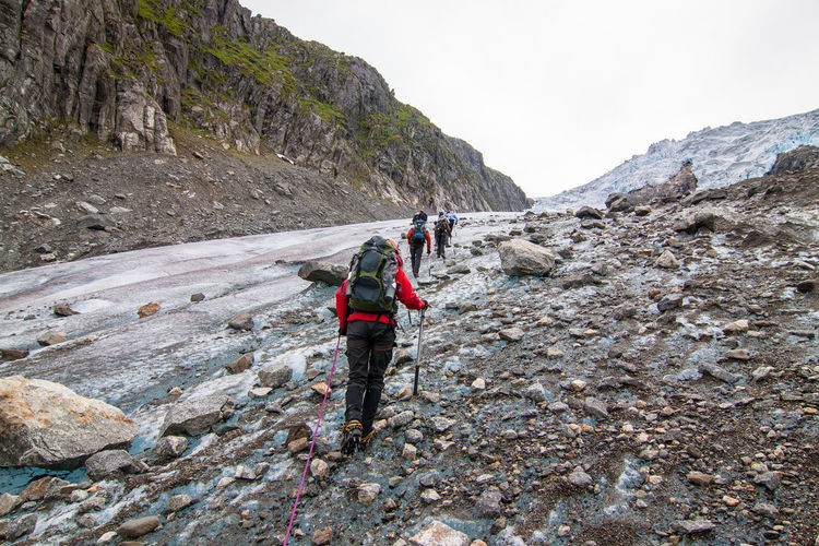 Adventure Challenge Cold Temperature Landscapes With WhiteWall Escapism Geology Getting Away From It All Glacier Glacier Walk Group Of People Hiking Hill Ice Landscape Mountain Mountain Range Norway Outdoors Physical Geography Remote Snow Stones Buarbreen Folgefonna Ice Age