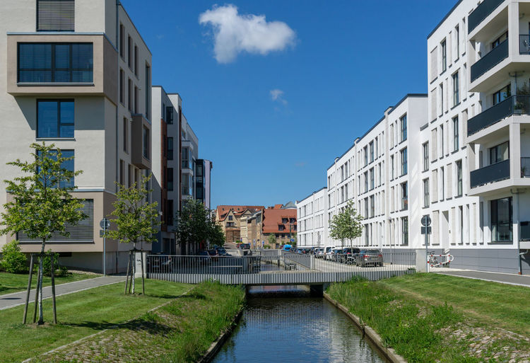 modern buildings for living in the city of rostock Building Exterior Architecture Built Structure Building Day City Water No People Cloud - Sky Sky Nature Residential District Outdoors Transportation Canal Plant Window Blue Sunlight Apartment