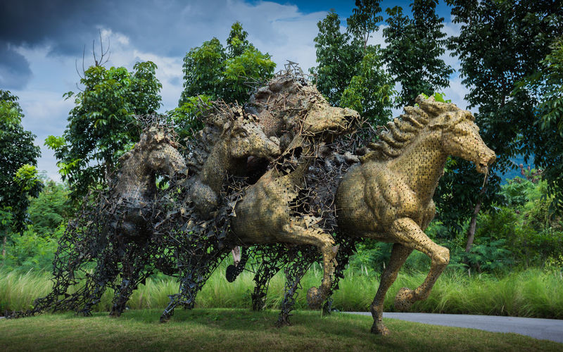 Monday, August 21, 2017 2:45 PM at khaoyai resrot ,Thailand news photo Horse Sculpture Animal Themes Arts Culture And Entertainment Day Domestic Animals Field Grass Green Color Growth Mammal Nature No People One Animal Outdoors Sky Tree