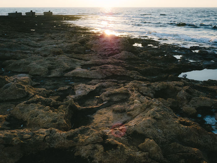 Beauty In Nature Day Nature No People Outdoors Reflection Rocky Coastline Sea Sun Sunlight Sunset Tranquility Water Wilderness Copy Space