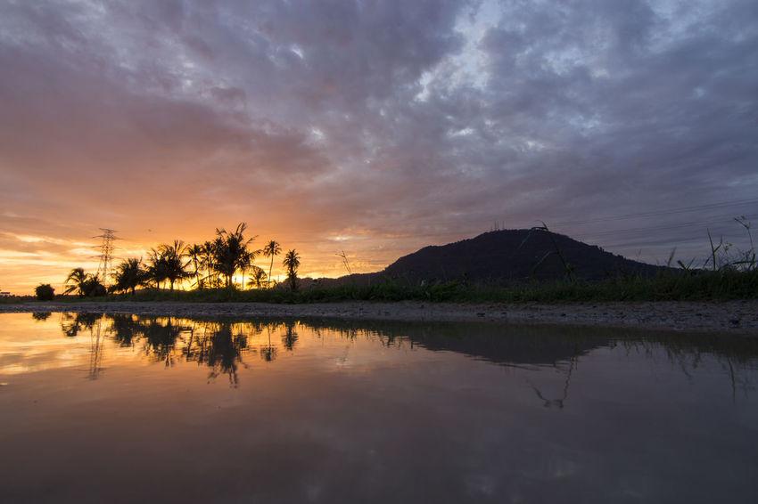 Cherok Tokkun hill with stunning sunrise at Permatang Rawa, Bukit Mertajam. Light Morning Ray Beauty In Nature Lake Mountain Nature No People Outdoors Reflection Scenics Sky Sunset Tranquil Scene Tranquility Tree Water