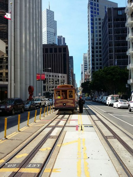 Cable Car in Downtown San Francisco. · San Francisco SF California CA USA Downtown Public Transport Railroad Track Train Urban Landscape Urban Geometry Architecture Highrises Skyscrapers Sunny Day Beautiful Day
