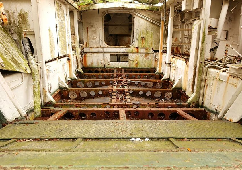 The interior of an old World War II landing craft Army Vehicles Bad Condition Landing Craft Military Equipment Military Vehicles Obsolete Run-down Vintage World War II