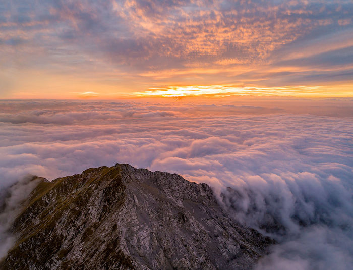 Sunset Landscape Cloud - Sky Sky Beauty Sun Outdoors Blue Beauty In Nature Tranquility Summer Nature Backgrounds Gold Colored Scenics Pink Color No People Dawn Mountain Peak Aerial Aerial Photography Hikingadventures Freshness Aerial View Perspectives On Nature