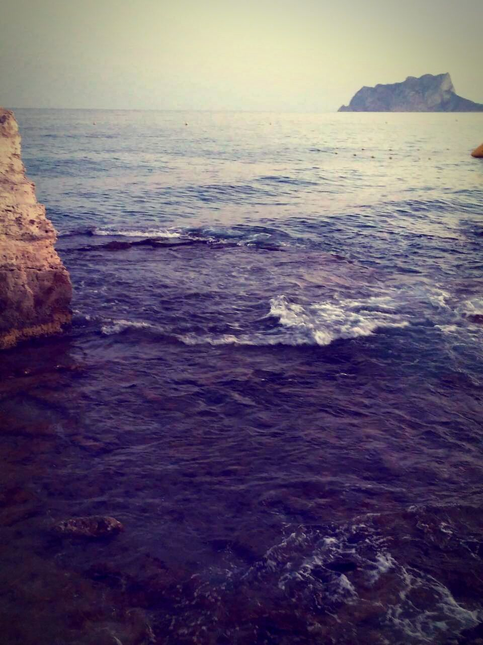 sea, water, nature, beauty in nature, scenics, horizon over water, tranquil scene, rock - object, tranquility, no people, wave, beach, outdoors, sky, day