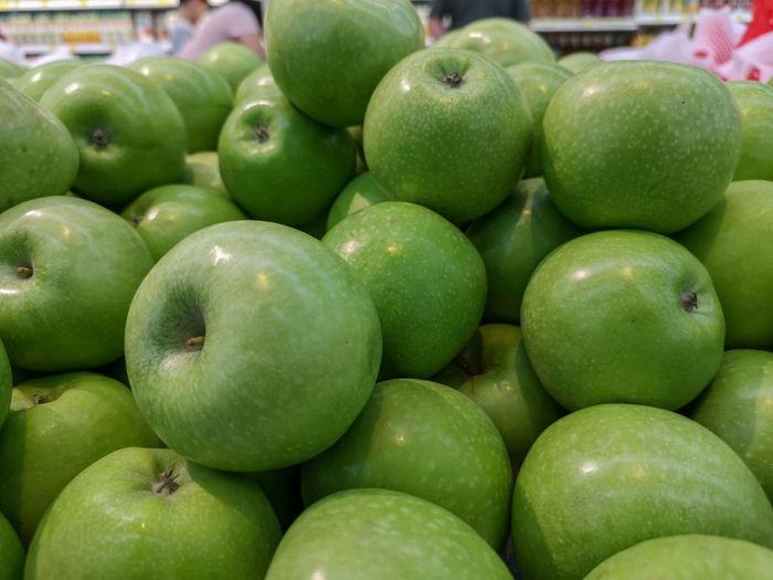 Delicious green apples Apple Green Green Apple Supermarket Dessert Topping Fruit Healthy Lifestyle Market Snack Social Issues Granny Smith Apple Dessert Farmer's Market Market Stall