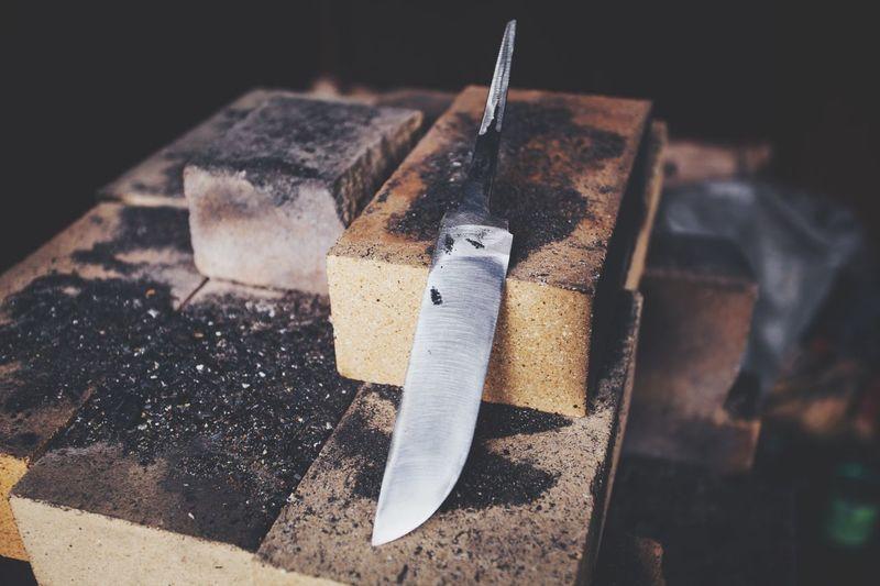 Close-up of knife on bricks