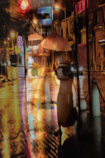 Blurred motion of wet street at night