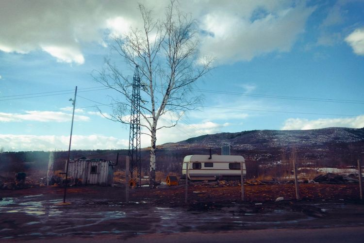 Camping Out Poverty Lives. Rainy Days Wintertime Architecture Bare Tree Building Exterior Cloud - Sky Day Desolate Destruction Housing Settlement Mountains And Sky Nature No People Off Road Outdoors Sky Tree Unsettled Vagabundos