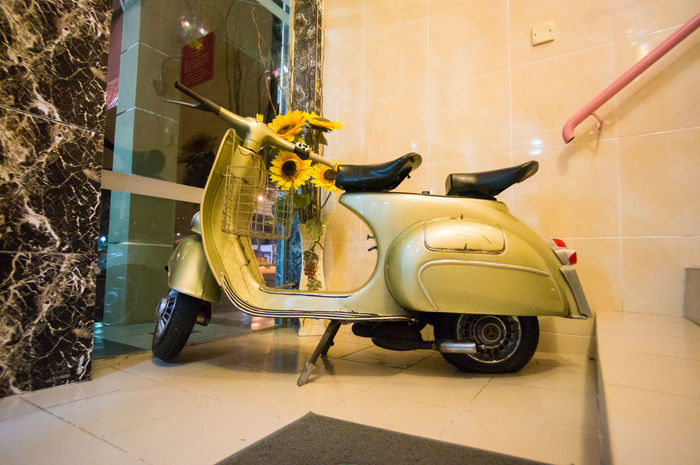 display scooter Two Seater Built Structure Flooring Mode Of Transportation Motor Scooter Motor Vehicle Old Scooter Tiled Floor Transportation Vintage Scooter Wheel Yellow
