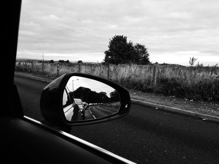 Reflection in side-view mirror