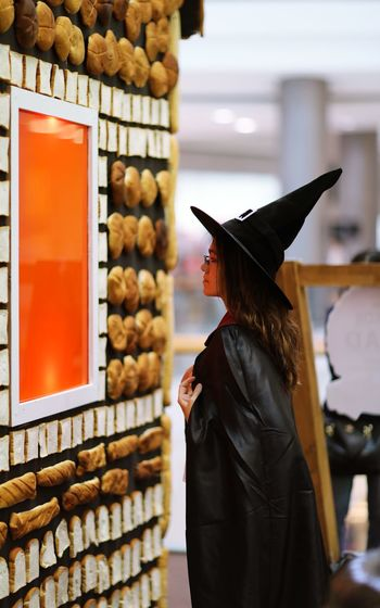 Side view of woman wearing witch costume