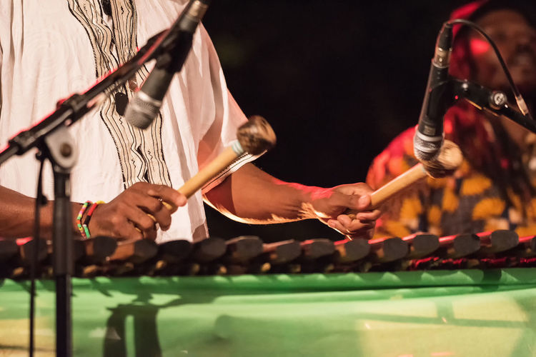 Arts Culture And Entertainment Drum - Percussion Instrument Hand Holding Human Body Part Human Hand Indoors  Men Midsection Music Musical Equipment Musical Instrument Nightlife Occupation People Performance Playing Real People Selective Focus Skill  Stage
