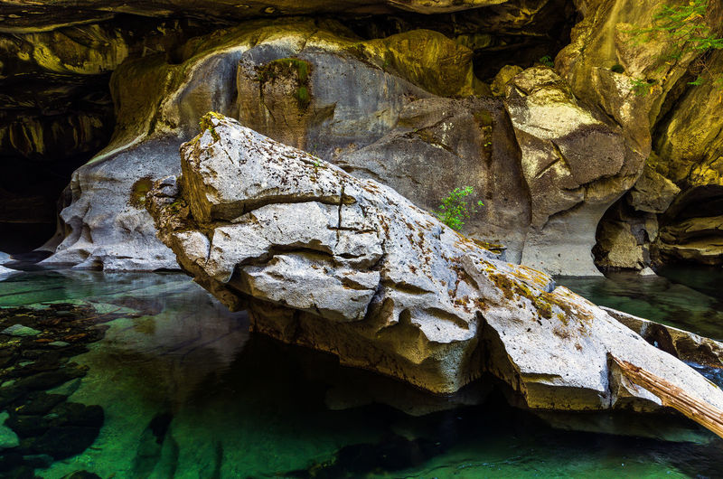 Little Husan Caves, near Woss, British Columbia Water Solid Rock Rock - Object Rock Formation Nature No People Beauty In Nature Geology Day Waterfront Tranquility Cave Physical Geography Non-urban Scene Outdoors Textured  Scenics - Nature Eroded Flowing Flowing Water