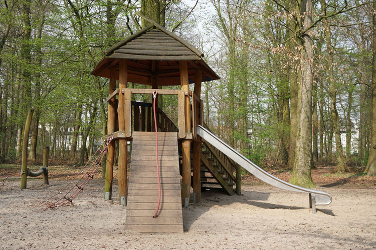 Childhood Climbing Contraption Day Forest Hut Ladder Nature No People Outdoor Play Equipment Outdoors Play Playground Slide Slide - Play Equipment Tree Tree House Wood Wood - Material Wooden WoodLand