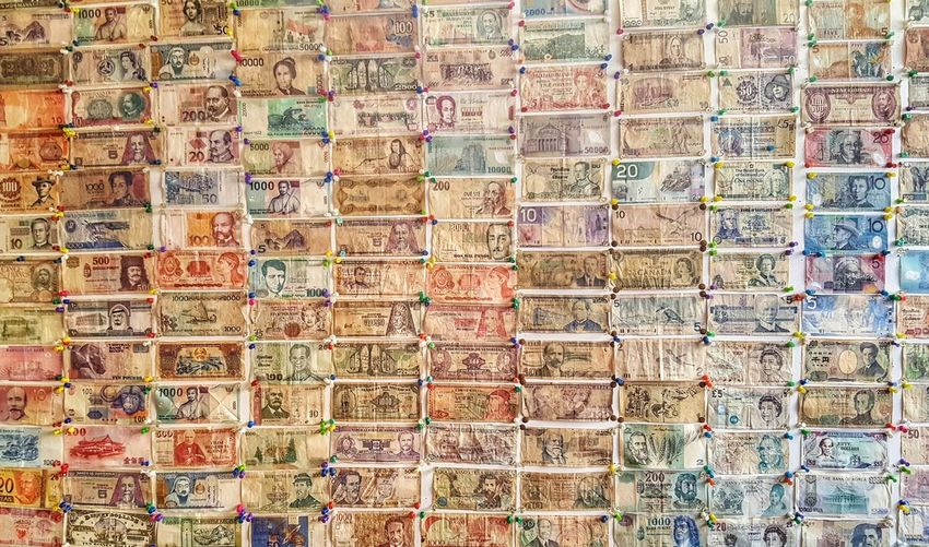International Wallpaper Europe ASIA Britain Japan China Africa World Money Wallpaper Paper Trail Push Pins Vertical Backgrounds Multi Colored Full Frame Pattern Variation Arrangement Close-up For Sale Display Retail Display Shop Market