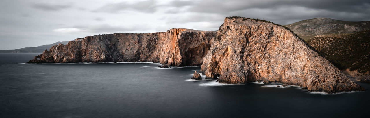 Dark look coastal stacks of cala domestica, sardinia, sulcis iglesiente