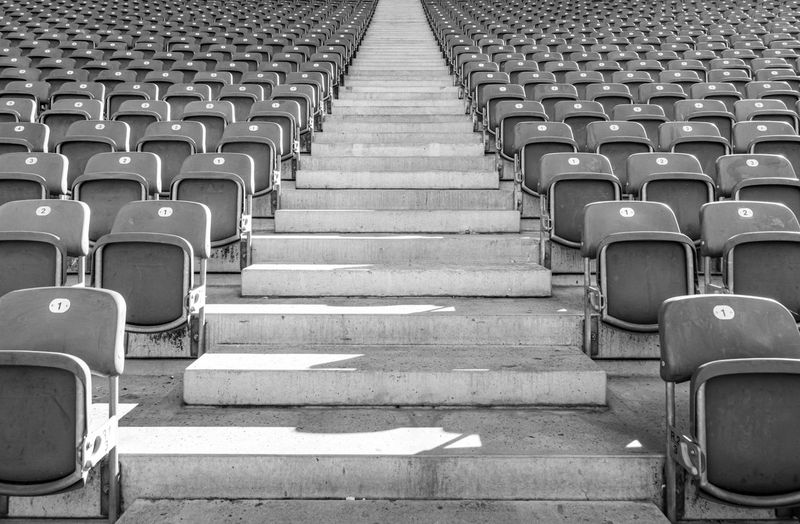 Empty seats in row at stadium